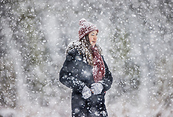 © Licensed to London News Pictures. 24/01/2021. London, UK. People walk in a snowy Bushy Park in south west London. A band of snow is crossing the south east this morning as temperature remain just above freezing. Photo credit: Peter Macdiarmid/LNP