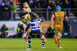 Jordan Williams of Bristol Rugby is challenged by Max Clark of Bath Rugby - Rogan Thomson/JMP - 18/11/2016 - RUGBY UNION - Recreation Ground - Bath, England - Bath Rugby v Bristol Rugby - Aviva Premiership.