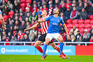 Christian Burgess of Portsmouth (6) and Charlie Wyke of Sunderland (9) in action during the EFL Sky Bet League 1 first leg Play Off match between Sunderland and Portsmouth at the Stadium Of Light, Sunderland, England on 11 May 2019.