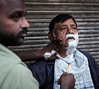 NEW DELHI, INDIA - CIRCA NOVEMBER 2018: Barber shop in the streets of Chandni Chowk in Old Delhi.