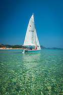 Costa Rei, Sardinia, Italy, June 2015. Sailing along the coast. Costa Rei is located on the south coast of Sardinia about 50km from Cagliari. The coastline is renowned for its crystal clear water, golden sands and long beaches. Photo by Frits Meyst / MeystPhoto.com