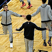ORLANDO, FL - MARCH 03: Trae Young #11 of the Atlanta Hawks high fives teammates prior to a game against the Orlando Magic at Amway Center on March 3, 2021 in Orlando, Florida. NOTE TO USER: User expressly acknowledges and agrees that, by downloading and or using this photograph, User is consenting to the terms and conditions of the Getty Images License Agreement. (Photo by Alex Menendez/Getty Images)*** Local Caption *** Trae Young