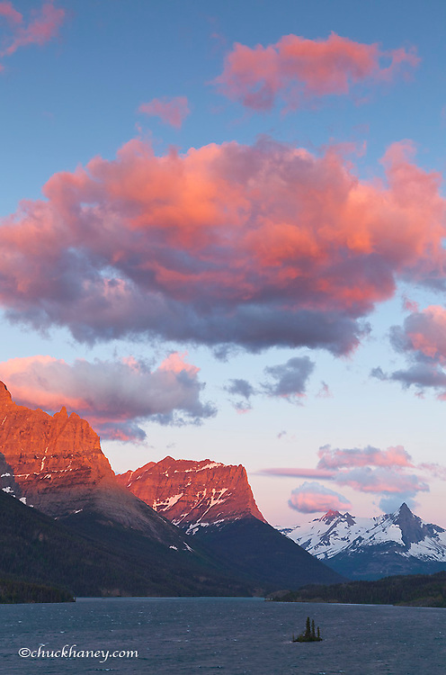 Red clouds at sunrise over St Mary Lake and Wild Goose Island in Glacier National Park, Montana, USA