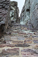 Stairs cut in rock at final segment to Comeau Pass trail Glacier National Park