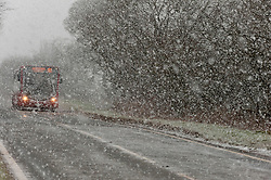 © Licensed to London News Pictures. 10/02/2020. Llanfihangel-nant-Melan, Powys, Wales, UK. A bus negotiates the dangerous road conditions on the A44 road near Llanfihangel-nant-Melan in Powys, during a heavy snow-fall this morning.  Photo credit: Graham M. Lawrence/LNP