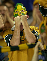 Photo: Richard Lane.<br />New Zealand v Australia. Semi-Final, at the Telstra Stadium, Sydney. RWC 2003. 15/11/2003. <br />An Australian fan celebrate victory.