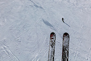 Pair of skis above a ski alope
