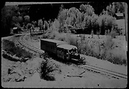"""RGS Goose #5 northbound in snow, passing the Newmire road bridge at Vanadium.<br /> RGS  Vanadium (Newmire), CO  Taken by Maxwell, John W. - 5/26/1949<br /> In book """"RGS Story, The Vol I: Over the Bridges-Ridgway to Telluride"""" page 308<br /> Thanks to Don Bergman for additional information."""