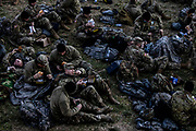 Idaho National Guard troops sleep and eat chow on the grass on the eastern front of the US Capitol building on Capitol Hill in Washington, DC, USA, 21 January 2021. Approximately 25,000 National Guard troops from all over the country were activated in order to protect the US Capitol and other locations in Washington following the January 6th attack on the Capitol by a pro-Trump mob. EPA-EFE/Samuel Corum