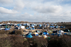 © London News Pictures. Calais, France. 15/01/16. The Afghan section of the Calais 'Jungle' refugee camp, which is soon to be cleared by police. French authorities are to bulldoze a 100-metre 'buffer zone' between the camp and the adjacent motorway, which leads to the ferry port. Photo credit: Rob Pinney/LNP