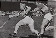Kilkenny Captain Jim Treacy clears his lines despite the attentions of John Flannagan.