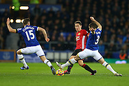 Ander Herrera of Manchester United (c) ia tackled by Tom Cleverley and Leighton Baines of Everton. Premier league match, Everton v Manchester United at Goodison Park in Liverpool, Merseyside on Sunday 4th December 2016.<br /> pic by Chris Stading, Andrew Orchard sports photography.