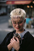 Punky young woman with her pet rat. Lyon, France.