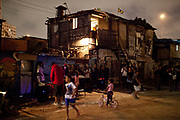 Favela do Moinho, the last one in the centre of Sao Paulo, hosts its own World Cup opening game and hip hop music event in the central yard of the community, good vibes, Sao Paulo, Brazil. World Cup 2014.