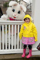 Rebecca Wittenburg hangs out with the Easter Bunny while waiting the the Easter Eggstravaganza Egg Hunt at Laconia Rotary Park Saturday afternoon.  (Karen Bobotas/for the Laconia Daily Sun)