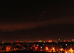 April 14, 2018 - Damascus, Syria - Surface-to-air missiles are seen over Syria's capital Damascus as the Syrian air defenses were responding to U.S. attacks. The U.S. started military actions against Damascus before daybreak Saturday as loud explosions were heard with ''red dots'' seen flying from earth to the sky. (Credit Image: © Ammar Safarjalani/Xinhua via ZUMA Wire)