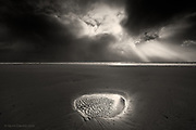 Nominee in Nature / B&W Spider Awards 2017<br /> <br /> We walked into sunshine before the blackest clouds blew overhead and then through the ominous blanket burst the most incredible light ladders and an isolated sand pool reflected the brilliance of a heavenly light