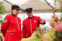 © Licensed to London News Pictures. 20/05/2019. London, UK.  Two Chelsea Pensioners views a floral display. <br /> The Royal Horticultural Society Chelsea Flower Show is an annual garden show held over five days in the grounds of the Royal Hospital Chelsea in West London. The show is open to the public from 21 May until 25 May 2019. Photo credit: Dinendra Haria/LNP