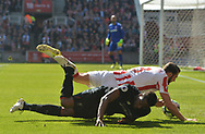 Liverpool's Divock Origi collides with Stoke's Eric Pieters .Premier league match, Stoke City v Liverpool at the Bet365 Stadium in Stoke on Trent, Staffs on Saturday 8th April 2017.<br /> pic by Bradley Collyer, Andrew Orchard sports photography.
