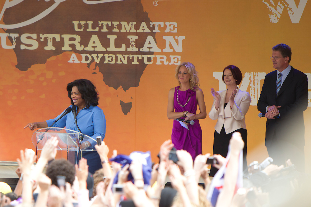 Oprah Winfrey, TV personality Carrie Bickmore, Australian Prime Minister Julia Gillard and Victorian premier Ted Baillieu address the crowd during a public event at Federation Square on December 10, 2010 in Melbourne, Australia. Oprah Winfrey is in Australia with 302 audience members from the US, Canada and Jamaica and will tape episodes of the 25th and final season of 'The Oprah Winfrey Show' from the Sydney Opera house next week. The shows will air in the US and Australia in January 2011.