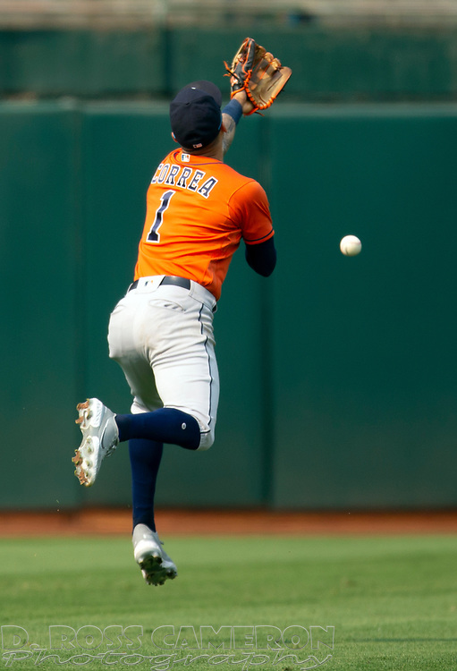 Sep 25, 2021; Oakland, California, USA; Houston Astros shortstop Carlos Correa (1) cannot get a glove on a bloop RBI single by Oakland Athletics second baseman Josh Harrison during the seventh inning at RingCentral Coliseum. Mandatory Credit: D. Ross Cameron-USA TODAY Sports