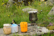 Brewing herbal tea outdoors in nature. Photogrpahed in the Austrian Alps