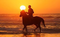 January 3, 2018 - Gaza City, Gaza Strip, Palestinian Territory - A Palestinian man rides a horse at the beach during sunset in Gaza City.   (Credit Image: © Ashraf Amra/APA Images via ZUMA Wire)