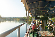 People enjoy a one-hour cruise in a boat on the Dniester River in Tiraspol, Transnistria. (September 10, 2016)