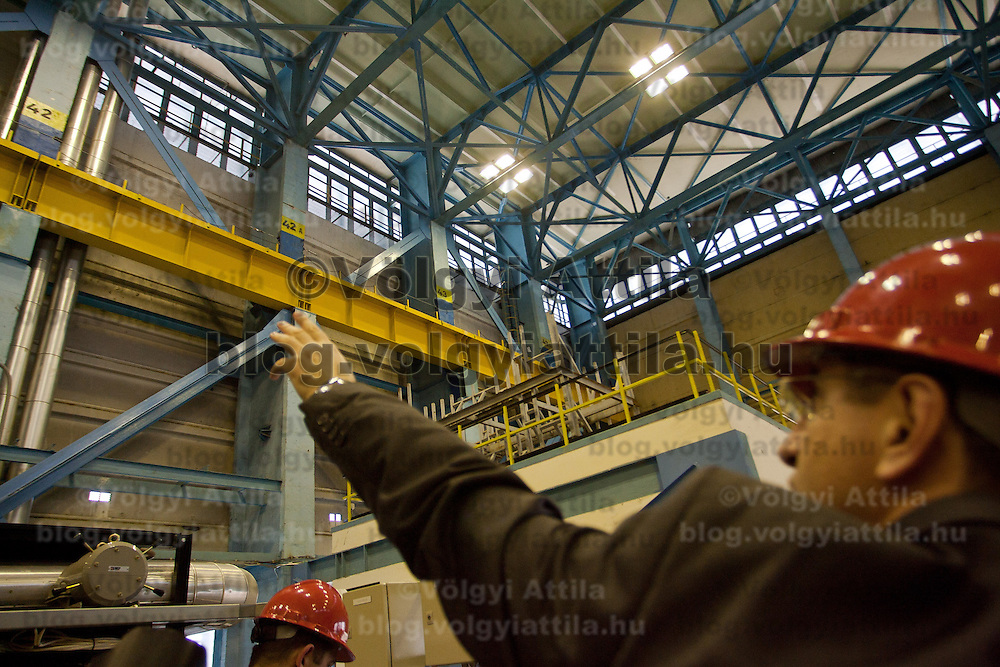Employee shows the X shaped additional structure elements errected to protect reactor building from a possible environmental catasthrope in the turbine unit number four building in Paks, 120 km (75 miles) east of Budapest, Hungary on March 23, 2011. ATTILA VOLGYI