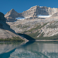 Crowfoot Mountain, Portal Peak & Mount Thompson (LtoR) rise above Bow Lake in Banff National Park, Alberta, Canada.