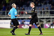 Manchester City midfielder Kevin De Bruyne (17) and Referee Jonathan Moss  exchange views during the Premier League match between Burnley and Manchester City at Turf Moor, Burnley, England on 3 December 2019.