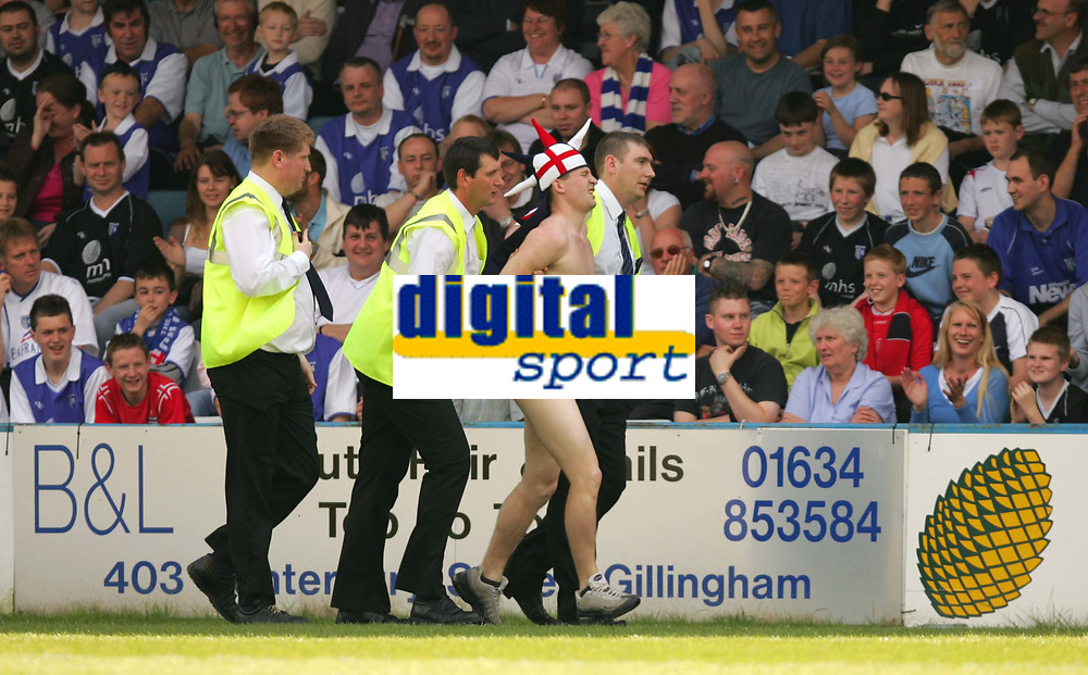 Photo:  Frances Leader.<br /> Gillingham FC v Cardiff City FC. Coca Cola Championship. <br /> Priestfield Stadium<br /> 30/04/05<br /> Stewards remove a steaker from the pitch during the first half of the game.