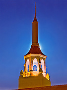 HDR image of The Arlington Theatre's tower and spire with full moon rising behind.