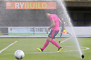 Sprinklers came on whilst the game was in play during the Pre-Season Friendly match between AFC Wimbledon and Queens Park Rangers at the Cherry Red Records Stadium, Kingston, England on 14 July 2018. Picture by Matthew Redman.
