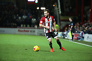 Brentford midfielder Alan Judge starting an attack during the Sky Bet Championship match between Brentford and Middlesbrough at Griffin Park, London, England on 12 January 2016. Photo by Matthew Redman.