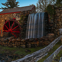 The Wayside Inn Grist Mill in Sudbury Massachusetts on a beautiful spring night in summer. A long exposure photography setting conveys the flowing water the falling waters across the Grist Mill.<br /> <br /> Sudbury Grist Mill photography images are available as museum quality photo, canvas, acrylic, wood or metal prints. Wall art prints may be framed and matted to the individual liking and interior design idea needs:<br /> <br /> https://juergen-roth.pixels.com/featured/sudbury-watermill-juergen-roth.html<br /> <br /> Good light and happy photo making!<br /> <br /> My best,<br /> <br /> Juergen<br /> Licensing: http://www.rothgalleries.com<br /> Photo Prints: http://fineartamerica.com/profiles/juergen-roth.html<br /> Photo Blog: http://whereintheworldisjuergen.blogspot.com<br /> Instagram: https://www.instagram.com/rothgalleries<br /> Twitter: https://twitter.com/naturefineart<br /> Facebook: https://www.facebook.com/naturefineart