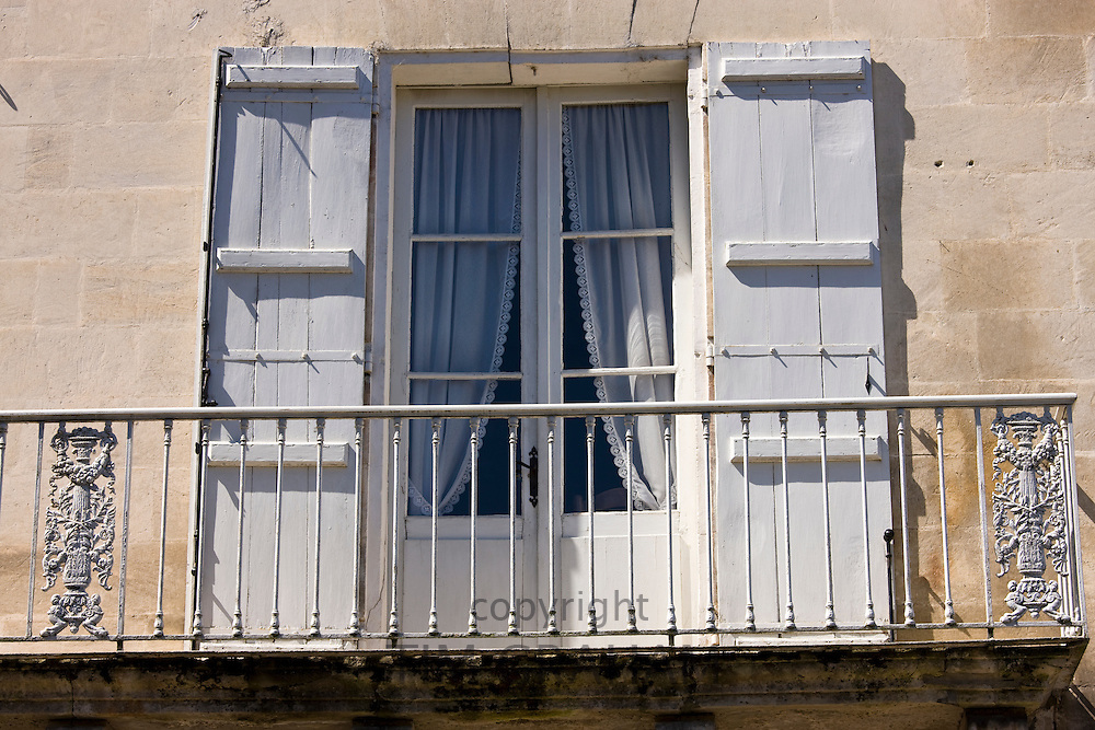 Traditional doors and shutters in town of Bourdeilles near Brantome in Northern Dordogne, France