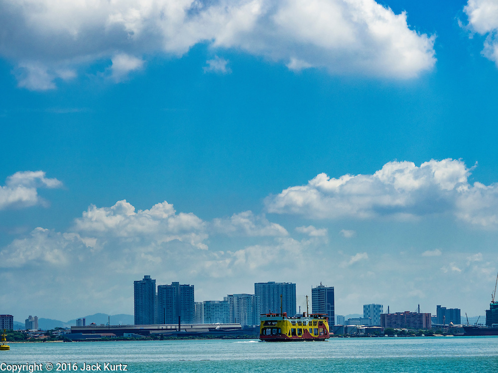 15 NOVEMBER 2016 - GEORGE TOWN, PENANG, MALAYSIA: The George Town - Butterworth Ferry sails towards Butterworth on the Malaysian mainland. George Town is a UNESCO World Heritage city and wrestles with maintaining its traditional lifestyle and mass tourism.           PHOTO BY JACK KURTZ