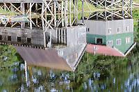 Wooden boathouse reflecting in Hammer Slough in Petersburg, Alaska.