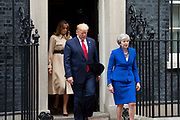 First Lady Melania Trump, U.S. President Donald Trump and Prime Minister Theresa May leave 10 Downing Street for the Foreign and Commonwealth Office during the second day of his State Visit on 4th June 2019 in London, United Kingdom.