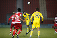 Darnell Johnson of AFC Wimbledon heads clear during the EFL Sky Bet League 1 match between Doncaster Rovers and AFC Wimbledon at the Keepmoat Stadium, Doncaster, England on 26 January 2021.