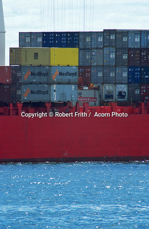 Container ship being loaded by a crane at the Fremantle Port.