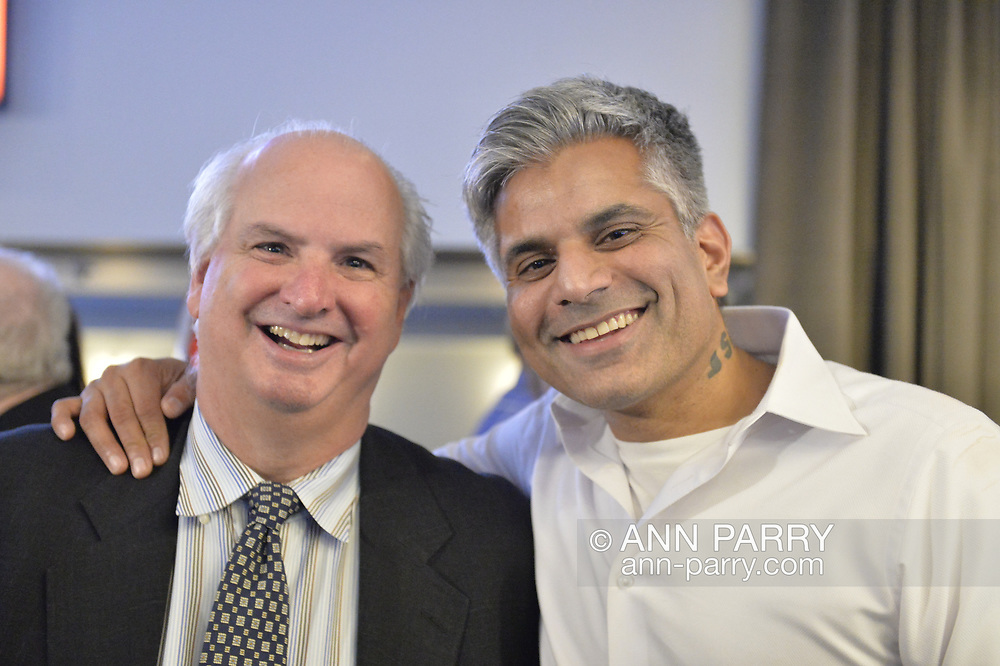 Garden City, New York, USA. November 6, 2018. Nassau County Democrats watch Election Day results at Garden City Hotel, Long Island. L-R, JEFF GOLD and RAY ARORA attended.