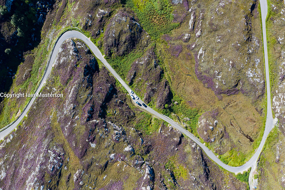 Aerial view of single track road on North Coast 500 tourist route near Clachtoll in Sutherland, Scotland UK