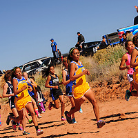 101213  Adron Gardner/Independent<br /> <br /> The Zuni Lady Thunderbirds pace together for the start of the girls varsity race at the Zuni Invitational cross country meet in Zuni Saturday.