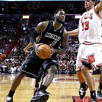 29 January 2012: Miami Heat small forward LeBron James (6) drives past Chicago Bulls center Joakim Noah (13) during the Miami Heat 97-93 victory over the Chicago Bulls at the AmericanAirlines Arena, Miami, Florida, USA.