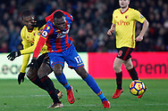 Christian Kabasele of Watford (L) fouls Christian Benteke of Crystal Palace (R). Premier League match, Crystal Palace v Watford at Selhurst Park in London on Tuesday 12th December 2017. pic by Steffan Bowen, Andrew Orchard sports photography.