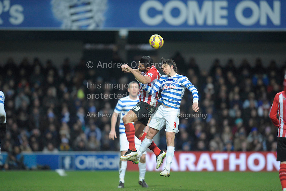 Joey Barton, the QPR captain and Graziano Pelle of Southampton compete for the ball. Barclays Premier league match, Queens Park Rangers v Southampton at Loftus Road in London on Saturday 7th Feb 2015. pic by John Patrick Fletcher, Andrew Orchard sports photography.