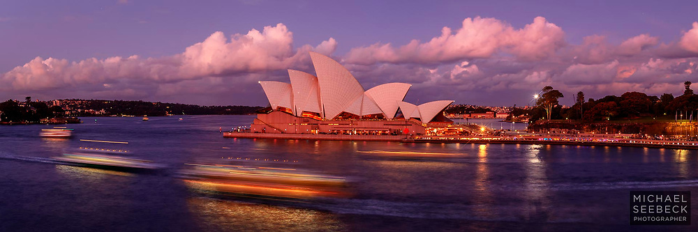 A high quality, high resolution photograph of harbour ferries plying the waters of Sydney Harbour with the Sydney opera House in the background.<br /> <br /> Code: HANM0006<br /> <br /> Limited Edition of 125 Prints