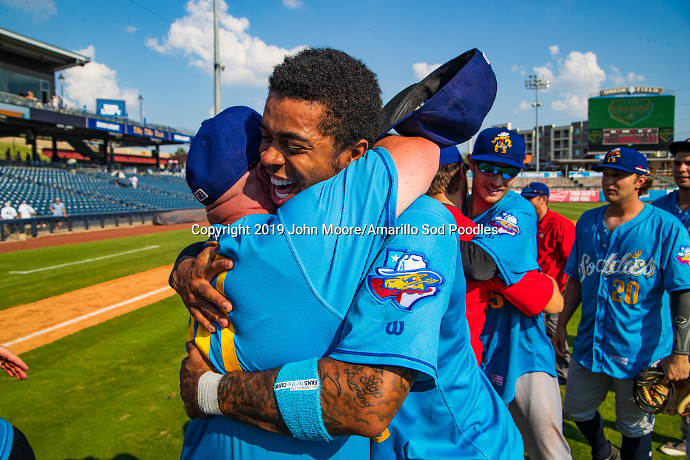 Amarillo Sod Poodles outfielder Buddy Reed (12) and Amarillo Sod Poodles Manager Phillip Wellman celebrates after the Sod Poodles won against the Tulsa Drillers during the Texas League Championship on Sunday, Sept. 15, 2019, at OneOK Field in Tulsa, Oklahoma. [Photo by John Moore/Amarillo Sod Poodles]